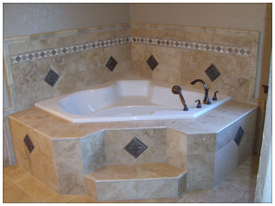 Jetted tub and beautiful tile work around it