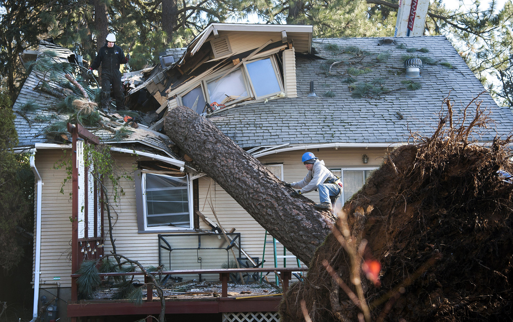 In this Nov. 21, 2015 photo, Jake Hines & Ross Rukke work to remove a fallen tree... (Dan Pelle/The Spokesman-Review, via AP) WASPO102